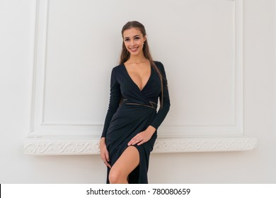 Portrait of a very beautiful smiling girl in an elegant dress. Large lips, extended eyelashes
