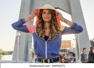Portrait of very beautiful sports woman dancing on the street, positive emotions, shining smile, enjoying her life, sports concept,attractive figure,cheerful,funky funny face