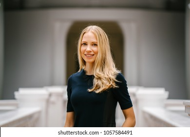 Portrait of a very beautiful white Caucasian woman in a black dress. She is blond with blue eyes, middle-aged, attractive, beautiful and smiling. She is a Russian expatriate living in Singapore.