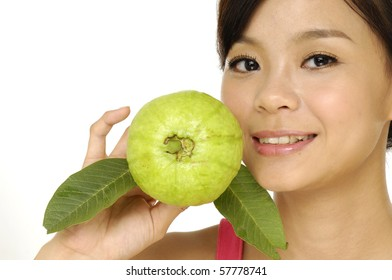 portrait of very cute woman holding fresh guava