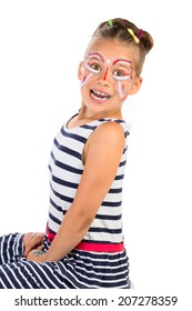 A portrait of very excited young girl with abstract face painting applied, isolated