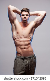 Portrait of a very fit young brunette guy.