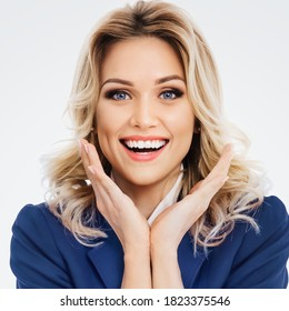 Portrait of very happy, jovial laughing beautiful young businesswoman in blue confident suit, isolated over grey background. Blond woman in studio business concept. Square composition image.
