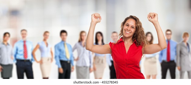 Portrait of a very happy woman in front of a group of people