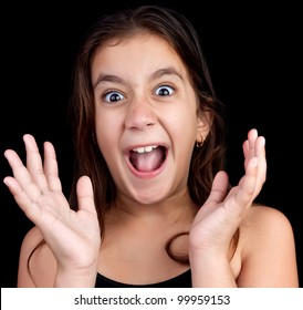Portrait of a very surprised or scared girl screaming loudly on a black background