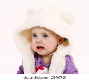 Portrait of very sweet little child sitting with toy in funny costume