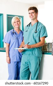 A portrait of a veterinarian and  assistant in a small animal clinic