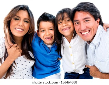 Portrait of a vey happy family smiling - isolated over white background