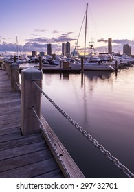 Portrait View of a Pier with Boats and Yachts Reflecting in the Canal and Overlooking Southport During a Beautiful Sunset, Main Beach, Gold Coast, Queensland, Australia