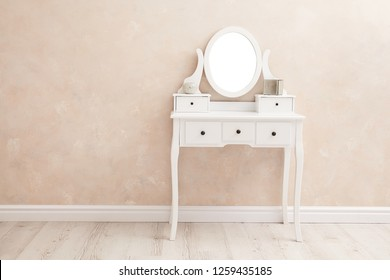 portrait of vintage vanity table set with three drawers and mirror - Image