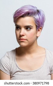 Portrait of a violet short-haired female model posing for the camera