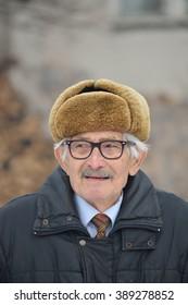 Portrait of vital elderly man, vertical orientation