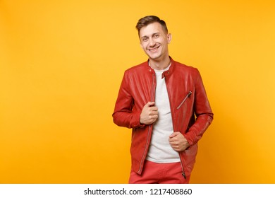 Portrait vogue confident handsome young man 25-30 years in red leather jacket, t-shirt stand isolated on bright trending yellow background. People sincere emotions lifestyle concept. Advertising area