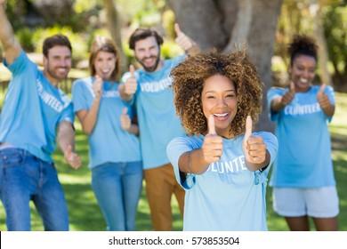 Portrait of volunteer group posing in park