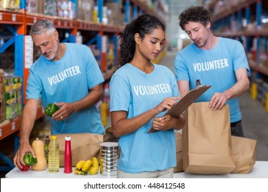 Portrait of volunteers working in a warehouse