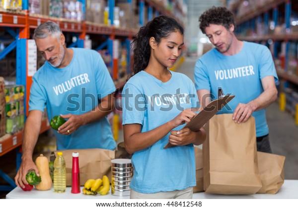 Portrait of volunteers working in a warehouse