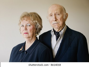 Portrait of Wealthy and Snooty Senior Citizens with Strong Woman and Cowering Man