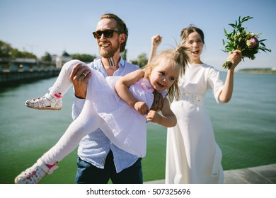 Portrait of wedding couples in love hipsters with cute baby