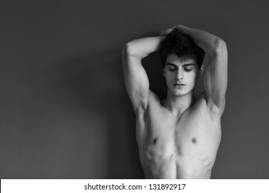 Portrait of a well built shirtless muscular male model, black and white