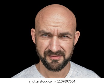 Portrait Of white bald man with beard in white t-shirt. isolate on a black background