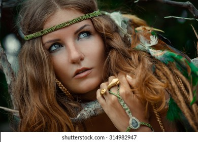 portrait of wild woman with feathers in her hair