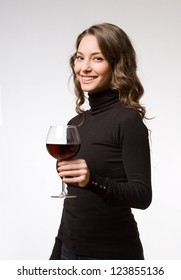 Portrait of wine tasting gorgeous brunette woman.