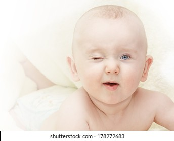 portrait of winking adorable lying relaxing toddler