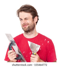 Portrait of winking caucasian forty years old manual worker with wall plastering tools isolated on white background