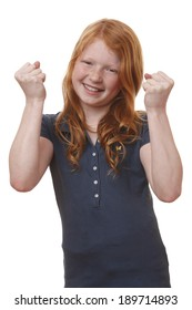 Portrait of a winning young girl on white background