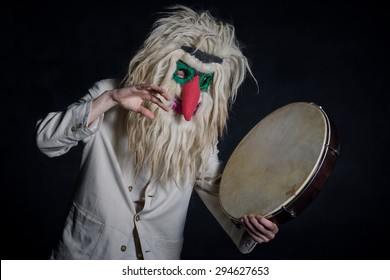 portrait of witch doctor wearing a traditional Romanian mask
