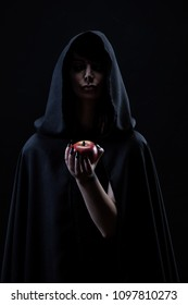 Portrait of a witch holding an apple in her hand