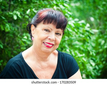 portrait of a woman aged over nature background
