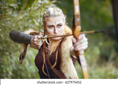 Portrait of a woman of the Amazon. Woman warrior hunting. Keep the bow in his hands.