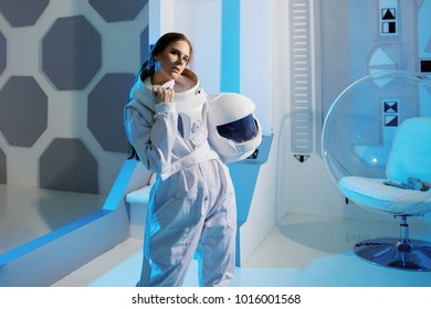 Portrait of a woman astronaut in a space suit, dreamy look up