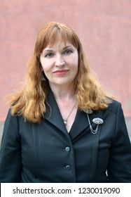 Portrait of the woman of average years in a black jacket
