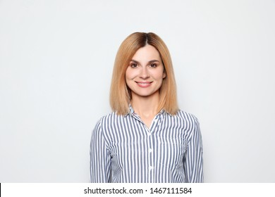Portrait of woman with beautiful face on white background