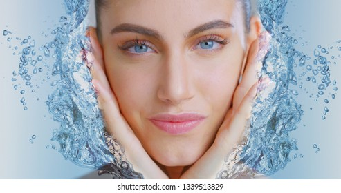 Portrait of woman with beautiful face and perfect skin just cleaned from impurities touching it gently with 3d water hands to show how soft, smooth and pure  it is.