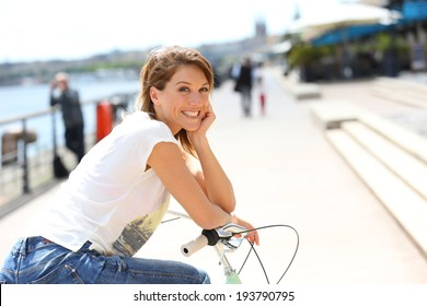 Portrait of woman with bicycle