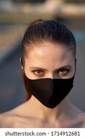 Portrait of a woman in the black mask to protect herself from the Covid-19 coronavirus in Bangkok, Thailand.