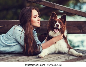 Portrait of woman with border collie dog