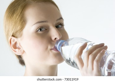 portrait of woman with bottle of water