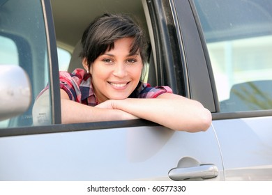 Portrait of a woman in a car