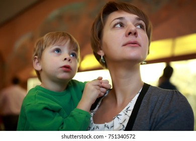Portrait of woman with child in museum