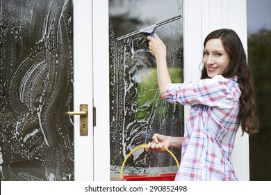 Portrait Of Woman Cleaning House Windows