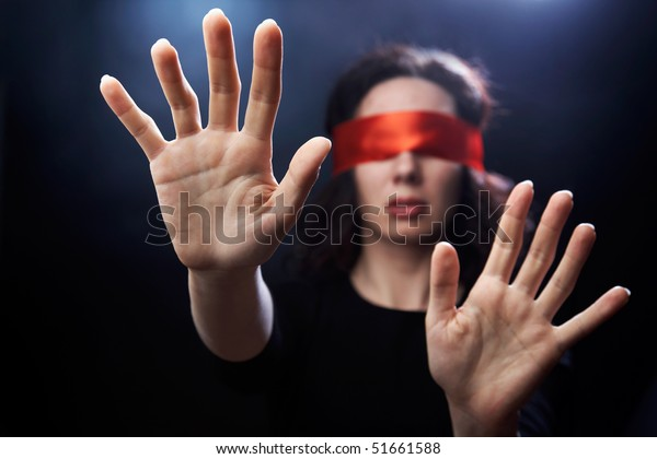 Portrait of woman with closed eyes and arms outstretched