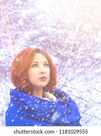 Portrait of a woman in a cold winter. Attractive smiling young girl walking in winter forest. Pretty woman in wintertime outdoor. Wearing winter clothes.