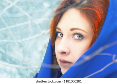 Portrait of a woman in a cold winter. Happy winter time. Well dressed woman enjoying the winter.