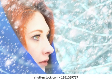Portrait of a woman in a cold winter. Stylish young girl walking in a winter day on the background of the park with snow.