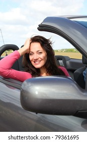 Portrait of woman in convertible car