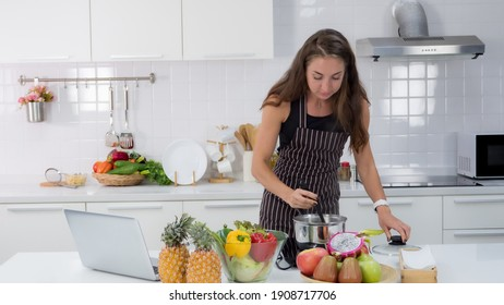 Portrait of woman cooking in the kitchen